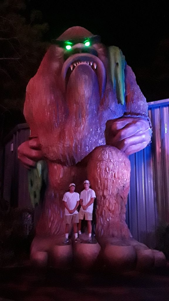 Guests posing with the Swamp Ape at Swampy Jack