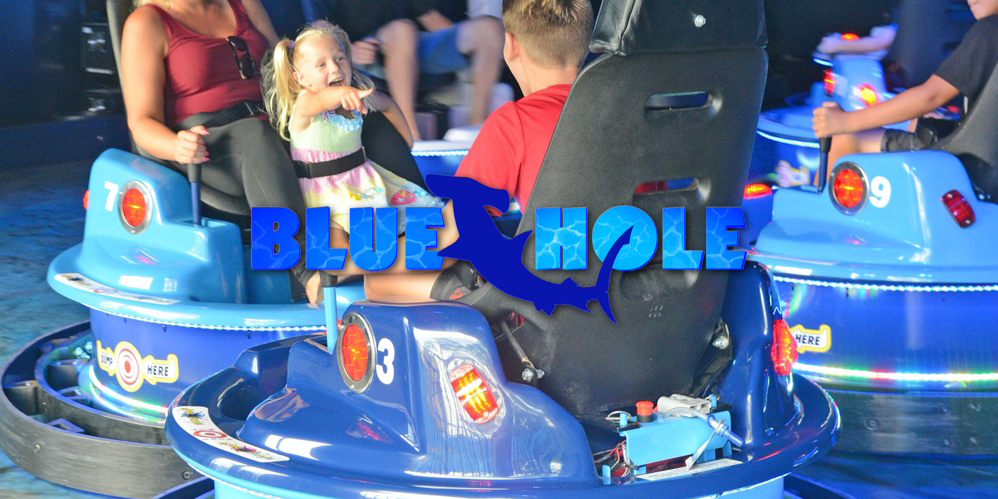 Logo for the Blue Hole interactive bumper cars attraction at Swampy Jack's Wongo Adventure in Panama City Beach, Florida